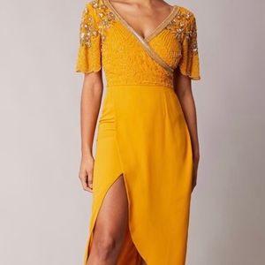 Virgo's Lounge yellow beaded dresses